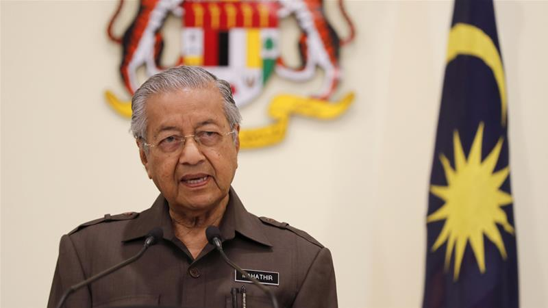 Malaysian Prime Minister Mahathir Mohamad says the new deal is a 'mutually beneficial agreement' [Vincent Thian/AP]