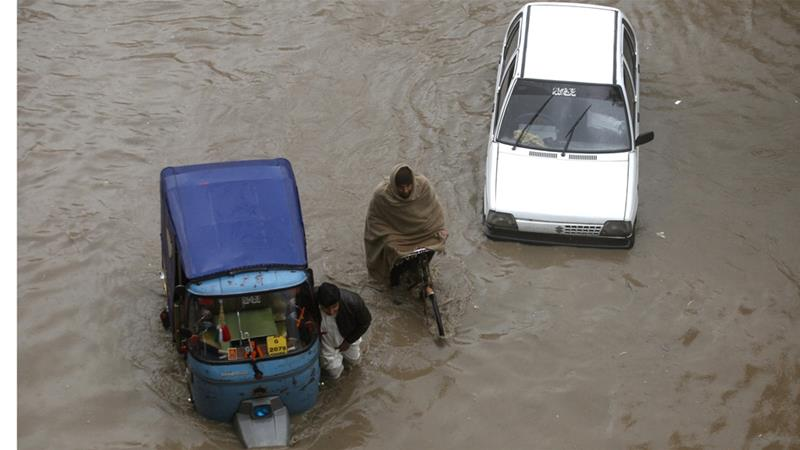 The flash floods come less than a month after heavy rains caused flooding in different cities of Pakistan, including Peshawar [File: Muhammad Sajjad/AP]