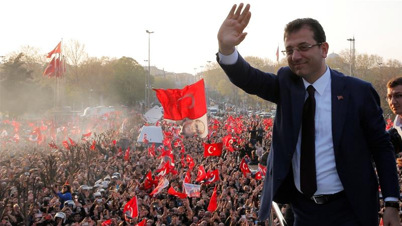 Ekrem Imamoglu greets his supporters after taking office in Istanbul [Huseyin Aldemir/Reuters]