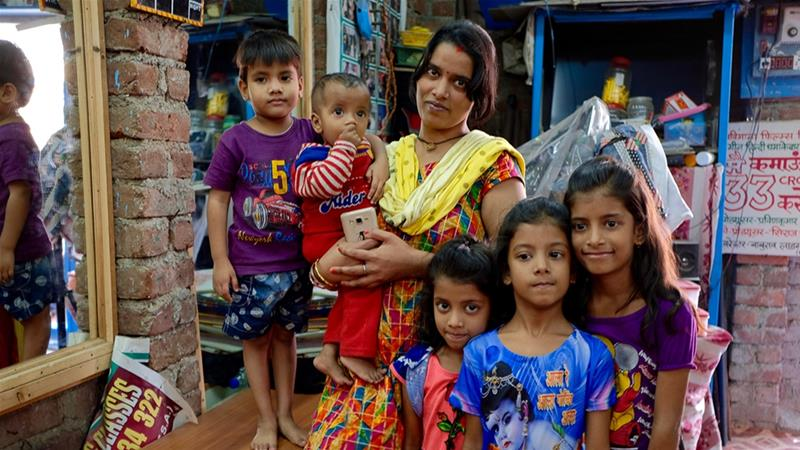 As the school closes for the day, Rekha arrives to collect her five daughters. 'Their fate isn't to get married and sit at home,' she says [Gayeti Singh/Al Jazeera]