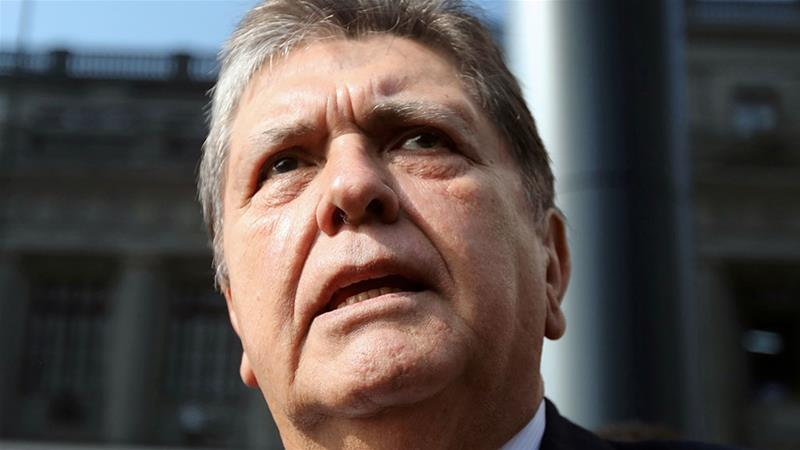 In this file image former Peruvian president Alan Garcia speaks to the media as he arrives at the National Prosecution office in Lima Peru in March 2018