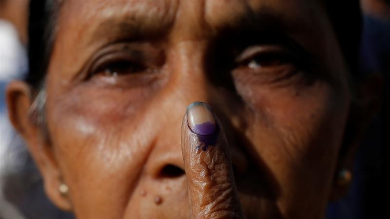 A woman shows her ink-stained finger after voting at a polling centre during the first phase of general election in Alipurduar district in West Bengal [File: Rupak De Chowdhuri/Reuters]
