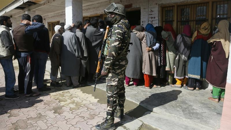 Thousands of troops were deployed to guard the vote in Kashmir, although turnout was less than 8 percent [Mukhtar Khan/AP]