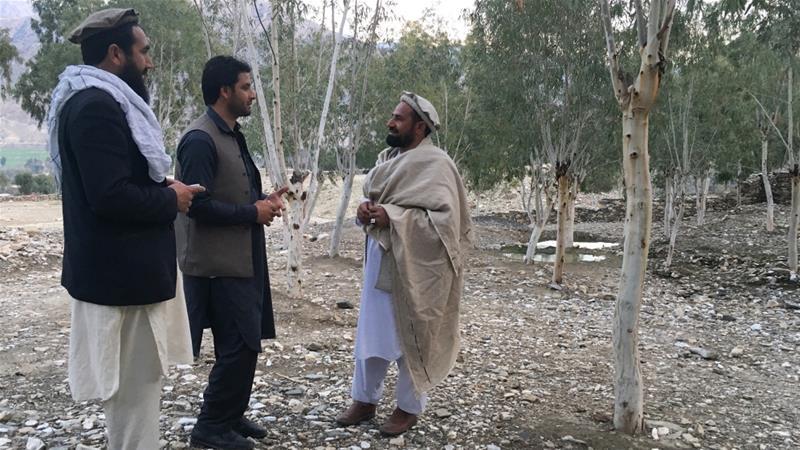 Men chat in a village near Asadabad, Kunar Province [Laura Cesaretti/Al Jazeera]