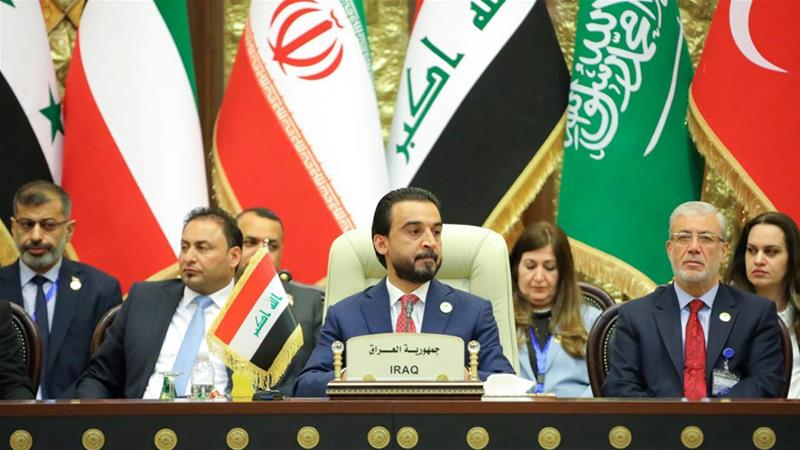 Speaker of the Iraqi parliament Mohammed al-Halbousi attends the Baghdad Summit on Saturday [Iraqi parliament media office via Reuters]