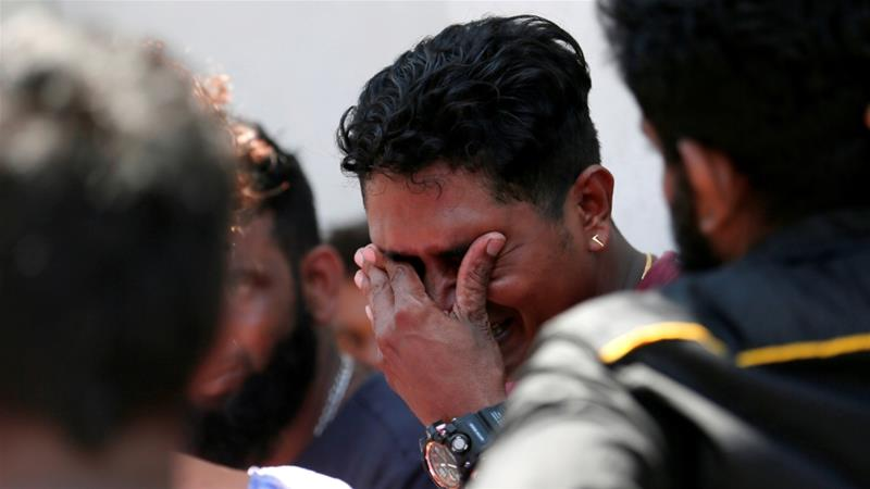 A relative of a victim of the explosion at St Anthony's Shrine reacts at the police mortuary in Colombo [Dinuka Liyanawatte/Reuters]