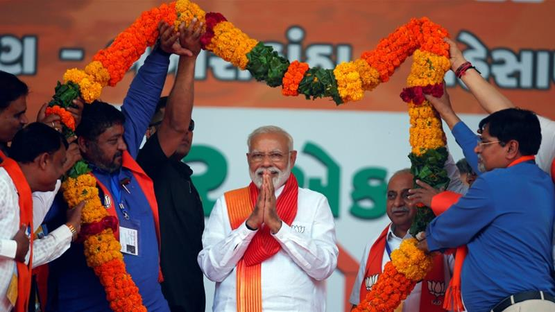 India's Prime Minister Narendra Modi gestures as he is presented with a garland during an election campaign rally in Patan, India, on April 21 [Reuters/Amit Dave]