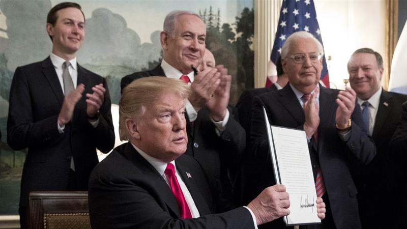 White House adviser Jared Kushner and Israeli PM Benjamin Netanyahu applaud as President Donald Trump shows a signed order recognising the Golan Heights as Israeli territory [Getty/Michael Reynolds]