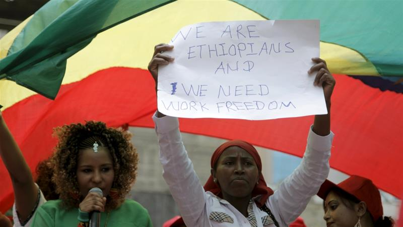An Ethiopian holds up a placard during a parade in Beirut to support the rights of migrant domestic workers in Lebanon [File: Alia Haju/Reuters]