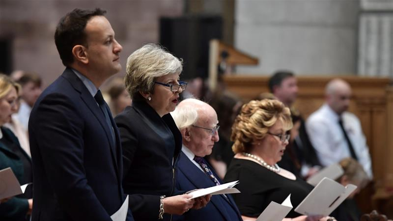 Ireland's Taoiseach (Prime Minister) Leo Varadkar, British Prime Minister Theresa May and Irish President Michael D Higgins attend McKee's funeral in Belfast [Charles McQuillan/Reuters]