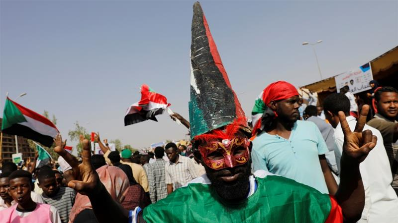 Tens of thousands holding placards marched through Khartoum's main streets [Umit Bektas/Reuters]