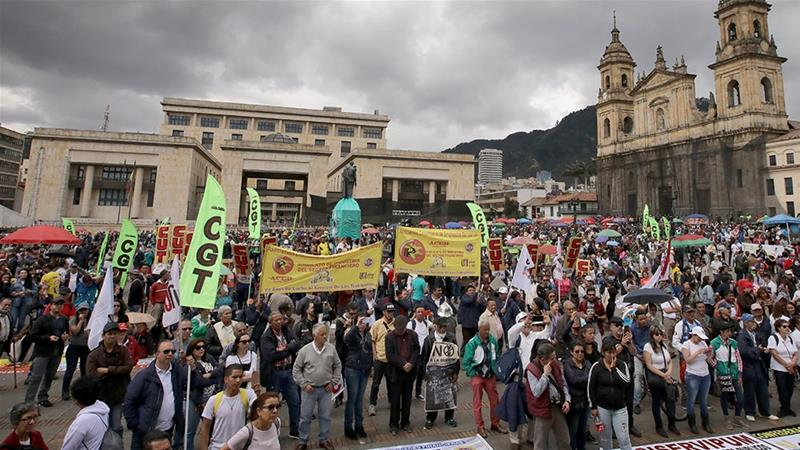 Protesters demonstrate at Bolivar Square during a march against the government of Colombian President Ivan Duque called by teachers'' and workers'' unions in Bogota [Daniel Munoz/AFP]
