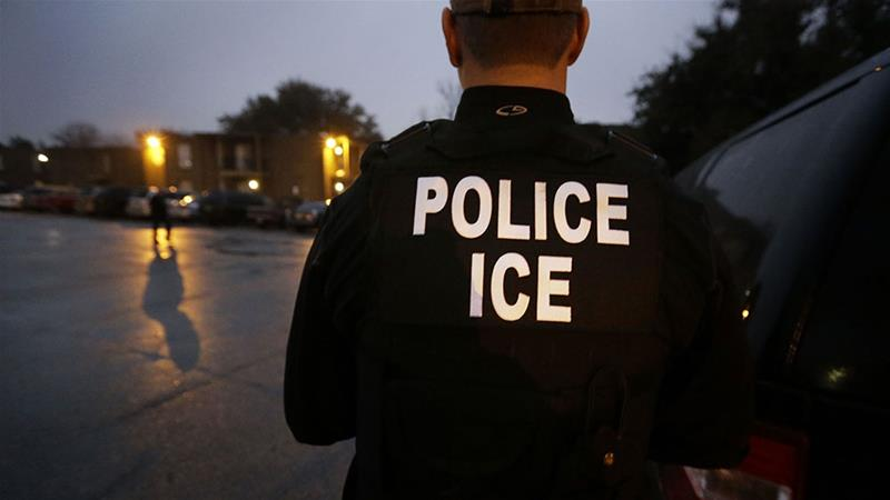 US Immigration and Customs Enforcement agents enter an apartment complex looking for a specific undocumented immigrant convicted of a felony during an early morning operation in Dallas [File: LM Otero/AP Photo]