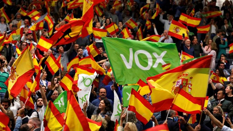 Supporters of Spain's far-right party Vox wave Spanish flags as they attend an electoral rally before general elections in the Andalusian capital of Seville on April 24 [Reuters/Marcelo del Pozo]