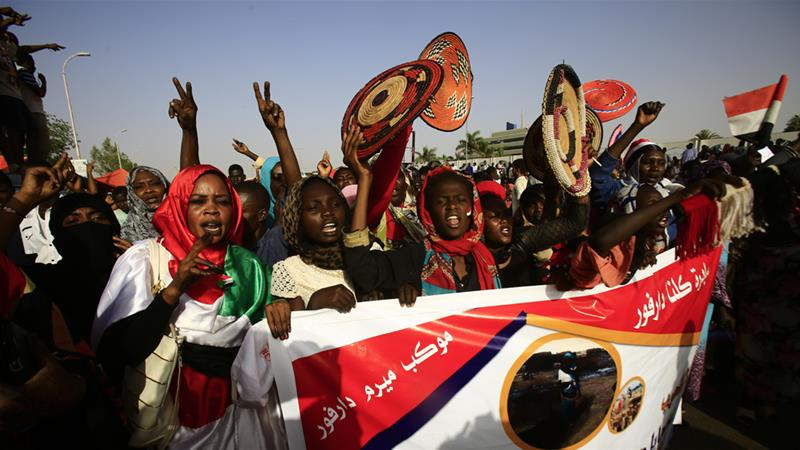 Protesters chant slogans as they gather near the military headquarters in the capital Khartoum on Saturday [Ashraf Shazly/AFP]