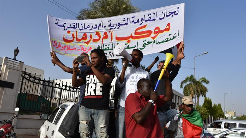 Protesters chant as they gather near the military headquarters in the capital Khartoum on Saturday [Omer Erdem/Anadolu]