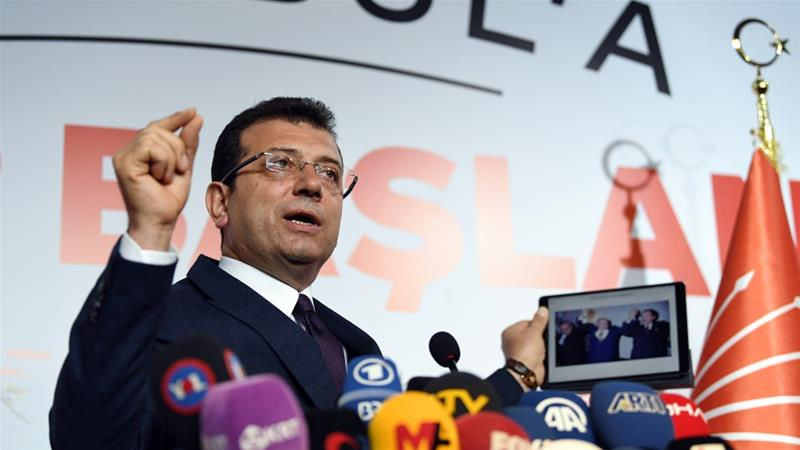 Initial results show opposition candidate Ekrem Imamoglu leading the Istanbul mayoral race with 48.79 percent of the vote [Ozan Kose/AFP]