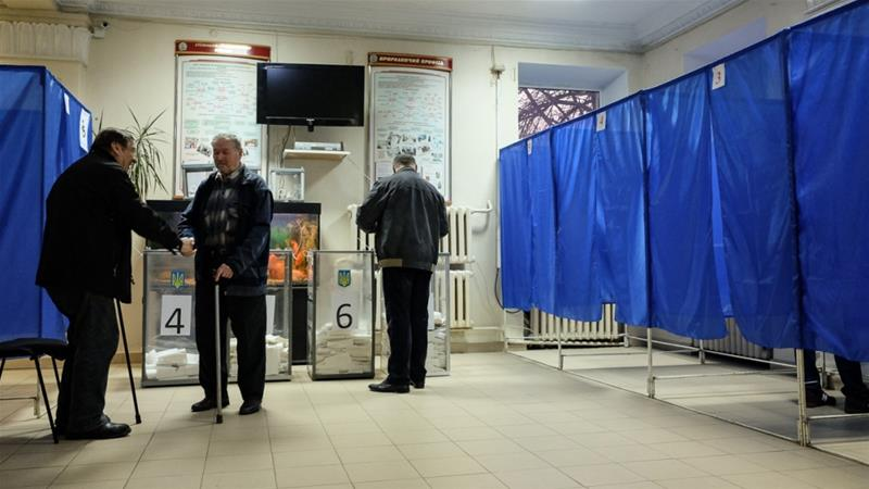 Voters pictured at a polling station in Dnipro, a central Ukraine city of about one million people [Maxim Edwards/Al Jazeera]