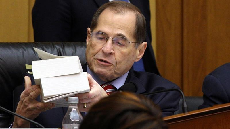 US House of Representatives Judiciary Committee Chairman Jerry Nadler holds up volumes of evidence related to President Bill Clinton's impeachment investigation as the committee debates before voting to subpoena Special Counsel Robert Mueller's full, unredacted report [File: Alex Wroblewski/Reuters]