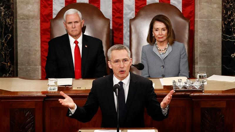 NATO Secretary-General Jens Stoltenberg, accompanied by Vice President Mike Pence, left, and House Speaker Nancy Pelosi, right, addresses a Joint Meeting of Congress on Capitol Hill in Washington [Patrick Semansky/AP Photo]