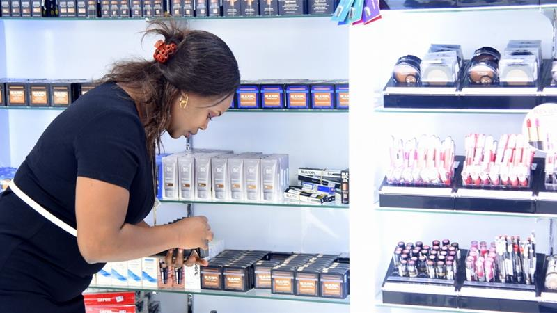 High-end beauty retailers in Kenya have to be vigilant against unscrupulous wholesalers who try and pass off fake cosmetics as brand-name items [Pauline Mpungu/Al Jazeera]
