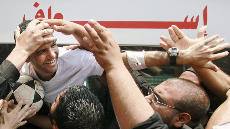 File: Palestinian football player Mahmoud Sarsak is greeted upon his arrival in Gaza City after being released from Israeli prison on July 10, 2012 [File: Mohammed Salem/Reuters]