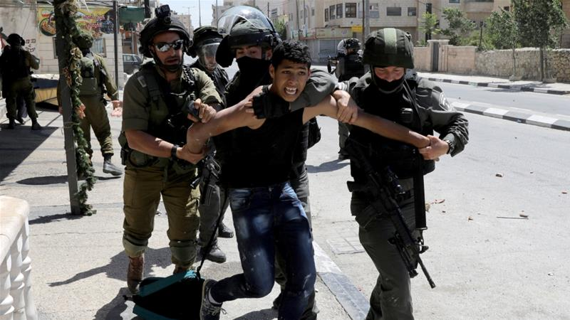 Israeli forces detain a Palestinian following a protest in support of Palestinian prisoners on hunger strike [File: Ammar Awad/Reuters]