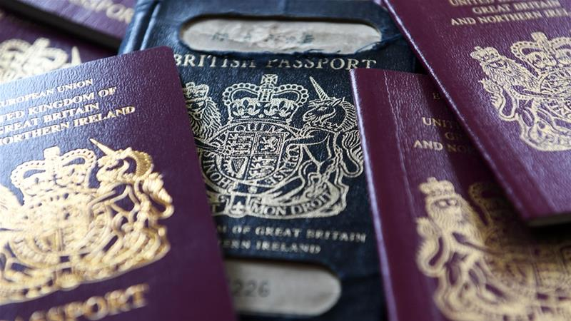 Post-Brexit UK passports are expected to be blue, but burgundy ones without the EU label are being issued [File: Andy Rain/EPA-EFE]