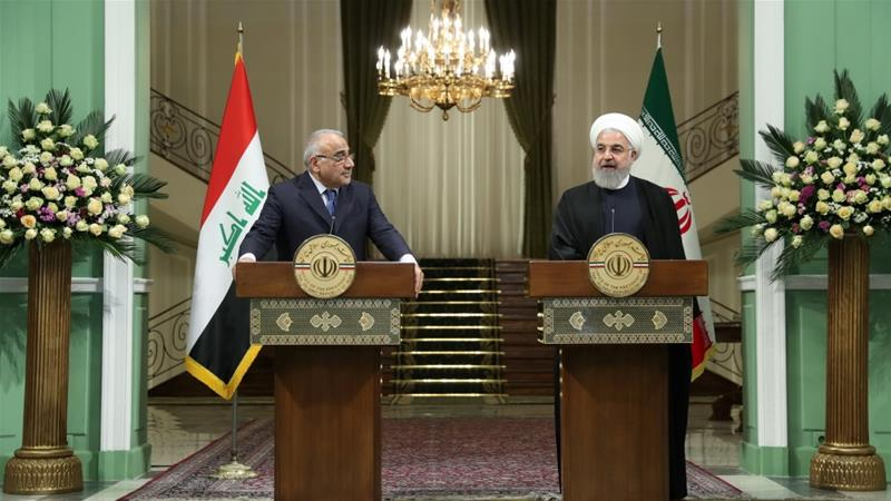 Rouhani (right) speaks during a news conference with Abdul Mahdi in Tehran [Reuters]