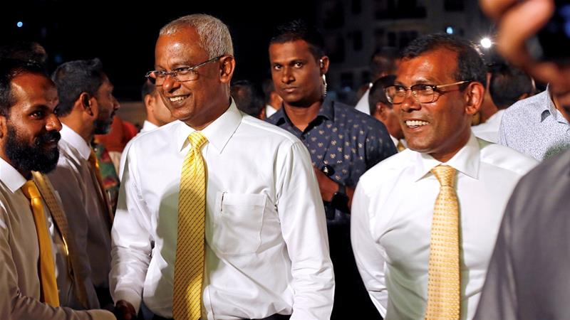 President Solih and his predecessor Nasheed on election night in Male on Saturday [Ashwa Faheem/Reuters]