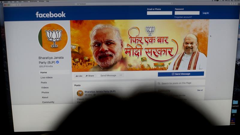 A woman checks the Facebook page of India's ruling Bharatiya Janata Party, in New Delhi [File: Manish Swarup/AP]