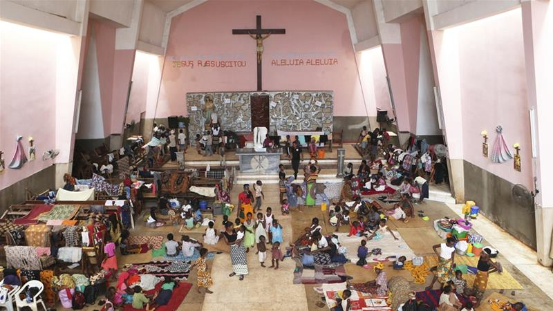 Women and children shelter inside a Roman Catholic Church in Pemba city Tsvangirayi Mukwazhi/ AP]