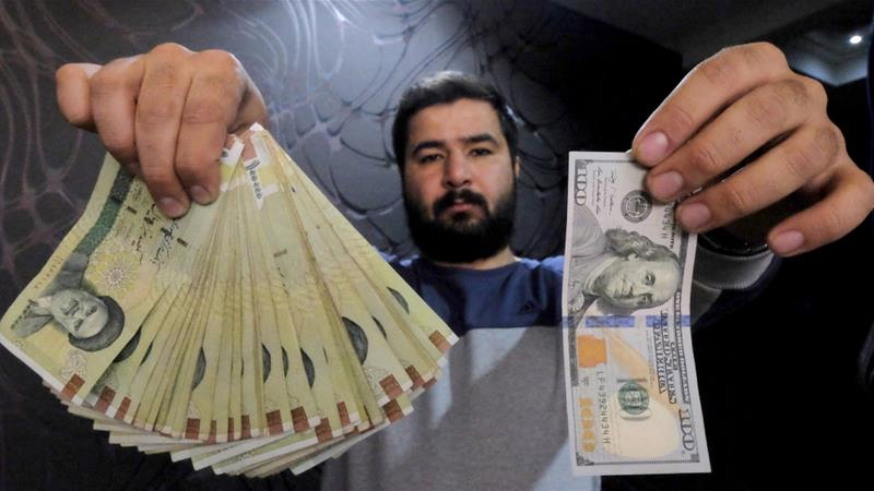 In 2018, the Iranian rial lost more than 100 percent of its value to the US dollar [File: Reuters/Raheb Homavandi]