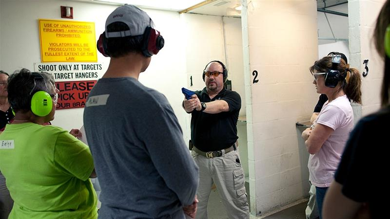 Firearms instructor Mike Magowan uses a rubber training pistol to demonstrate a shooting stance ,during a teachers-only firearms training class offered for free at the Veritas Training Academy in Sarasota, Florida  [File: Brian Blanco/Reuters]
