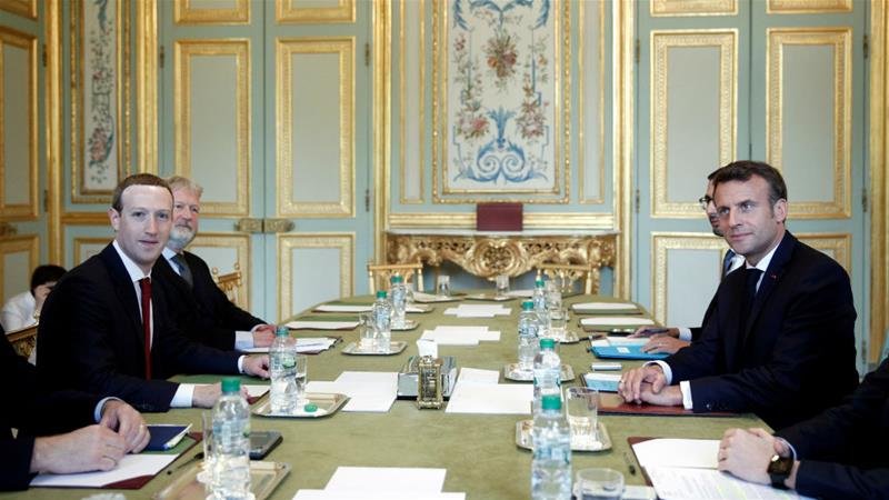 Facebook CEO Mark Zuckerberg, left, has taken a 'hands-on' approach to dealing with potential government regulation of his social network, meeting French President Emmanuel Macron in person [Yoan Valat/Reuters]