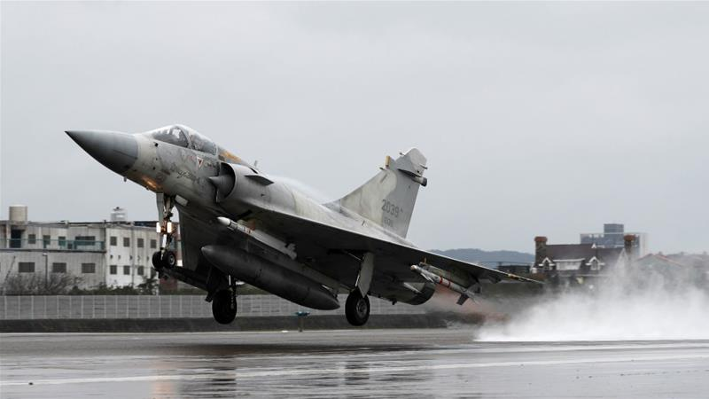 A Taiwan Air Force Mirage-2000 fighter jet takes off during military drills to test readiness [File: Tyrone Siu/Reuters]