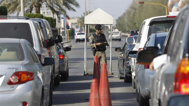 A Saudi police officer checks cars at a security checkpoint in Saudi Arabia's eastern Gulf coast town of Qatif [File: Fahad Shadeed/Reuters]