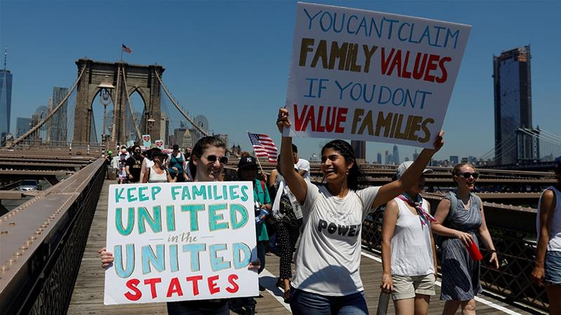 Demonstrators march on Brooklyn Bridge during a Keep Families Together march to protest the Trump administration's immigration policy in New York [File: Shannon Stapleton/Reuters]