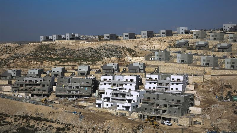 The international community has objected to Israel's moving people into settlements [Ariel Schalit/AP]