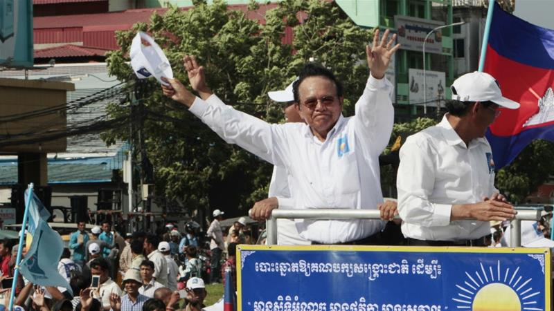 CNRP leader Kem Sokha greets supporters on the last day of campaigning ahead of local elections in 2017. He was detained a few months later and remains under house arrest [File: Heng Sinith/AP Photo]
