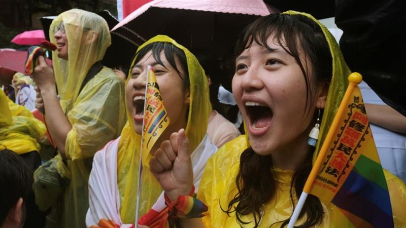 Same-sex marriage supporters rally outside Taipei's parliament building [Tyrone Siu/Reuters]
