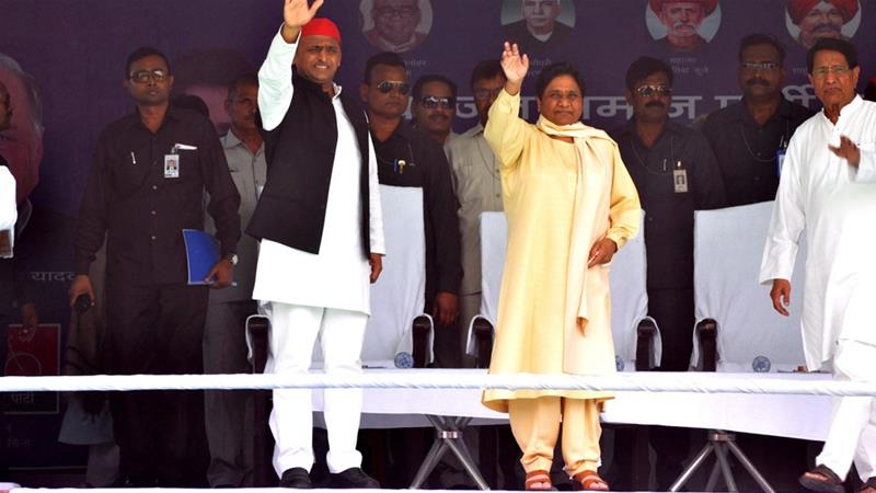 SP's Akhilesh Yadav wearing a red cap, BSP's Mayawati in the middle, and RLD's Ajit Singh at an election rally in Varanasi [Rajesh Kumar/Hindustan Times via Getty Images]