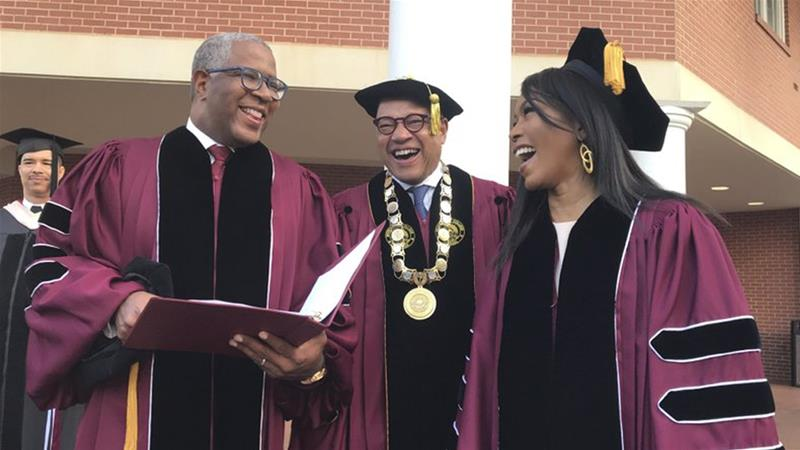 Robert F Smith, (left), laughs with David Thomas, (centre), and actress Angela Bassett at Morehouse College [Bo Emerson/Atlanta Journal-Constitution via AP]