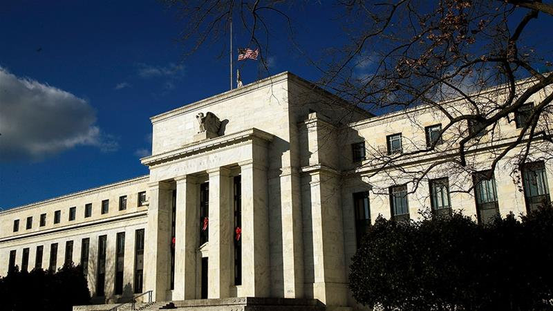 The US Federal Reserve is concerned by the risks of a global economic downturn and increasing uncertainty [Manuel Balce Ceneta/AP]