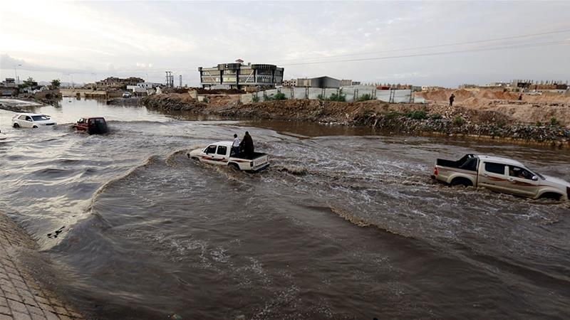 Vehicles drive through a flooded road following heavy rains in Sanaa, Yemen. [Yahya Arhab/EPA]