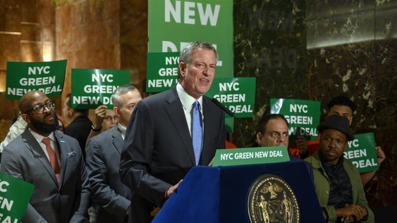 New York City Mayor Bill de Blasio speaks inside Trump Tower about the Green New Deal, serving notice to US President Donald Trump and demanding more energy-efficient buildings [Don Emmert/AFP]