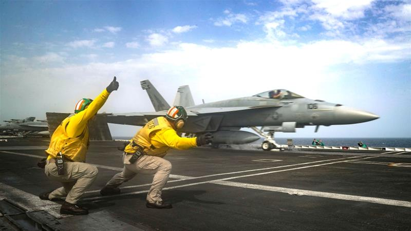 An F/A-18E Super Hornet is launched from the flight deck of the USS Abraham Lincoln in the Arabian Sea [Jeff Sherman/US Navy via Reuters]