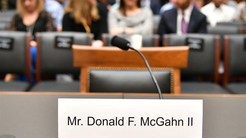 A seat and name card are set for former White House lawyer Don McGhan [Mandel Ngan/AFP]