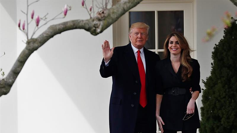 Trump stands next to former White House Communications Director Hope Hicks outside of the Oval Office [File: Carlos Barria/Reuters]
