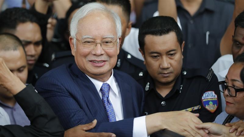 Former Prime Minister Najib Razak gets into a car after his court appearance at the High Court in Kuala Lumpur, Malaysia on April 3, 2019 [AP Photo/Vincent Thian]